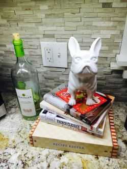 1.This is Stanley the frenchie, I thought him hangin' on top of the cookbook's was fitting