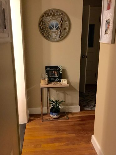 4. C shape table in hallway entry