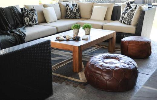 u-shaped-black-outdoor-sectional-ikat-pillows-union-jack-rug